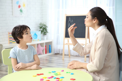 teacher and little girl on private lesson